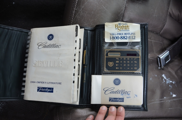1994 Cadillac Seville owner's booklet with calculator